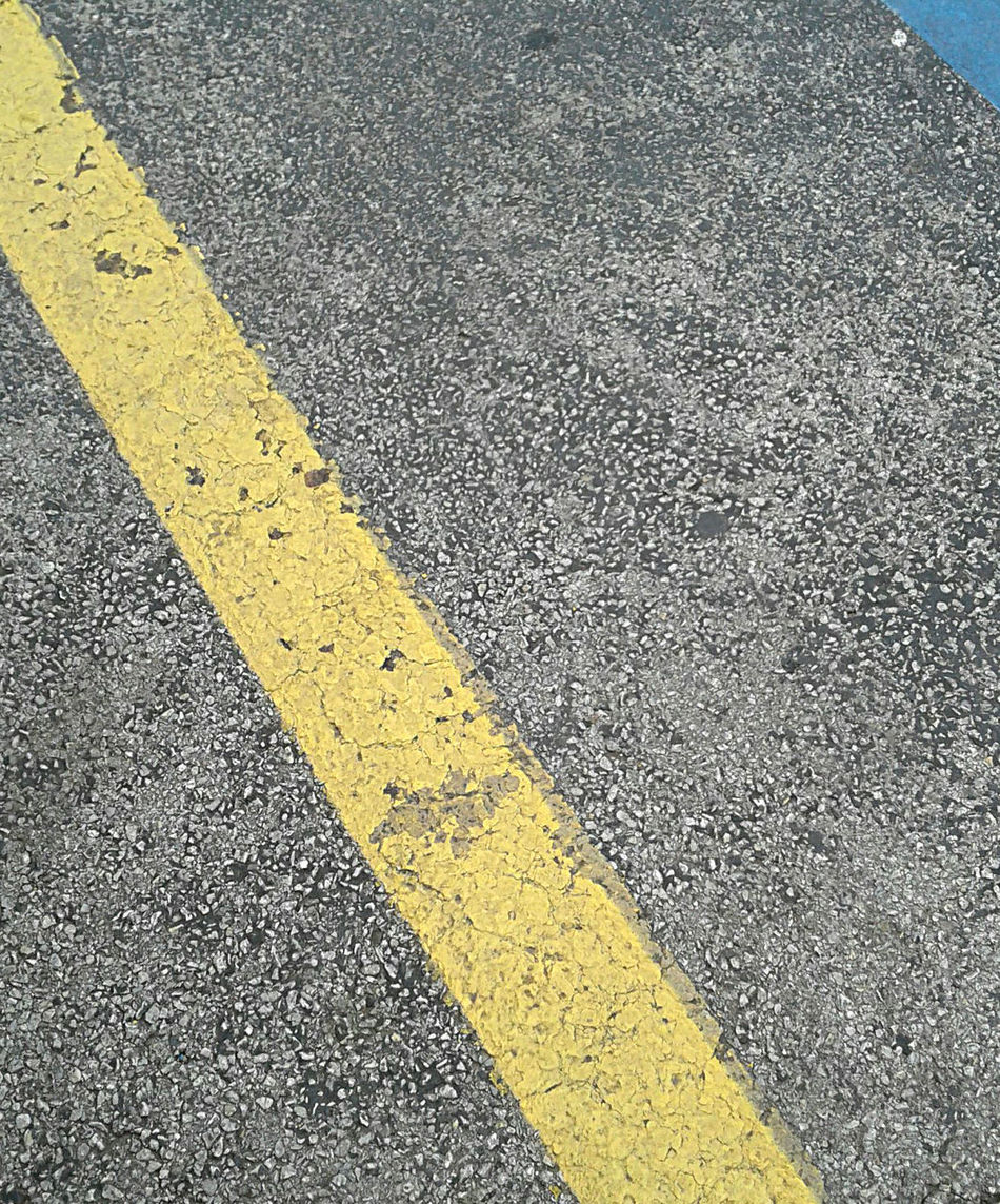 Lines on the pavement, directions. Yellow and blue on gray parking lot. Asphalt Blue Close-up Day Dividing Line Gray Gray Background High Angle View Lines No People Outdoors Painted Road Road Marking Street Textured  Transportation Yellow