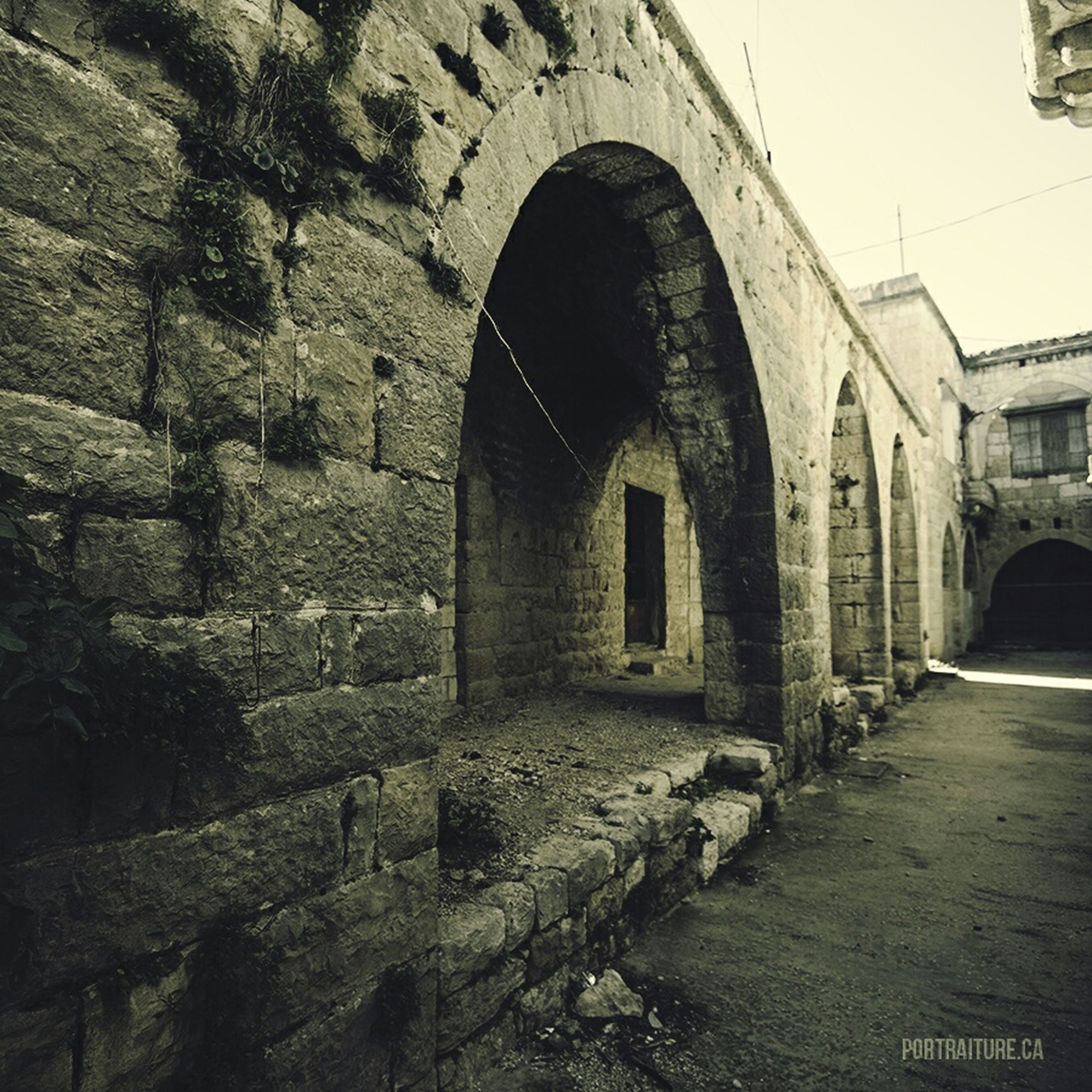 architecture, built structure, arch, building exterior, old, history, stone wall, wall - building feature, brick wall, the way forward, building, archway, abandoned, old ruin, the past, arched, tunnel, wall, day, indoors