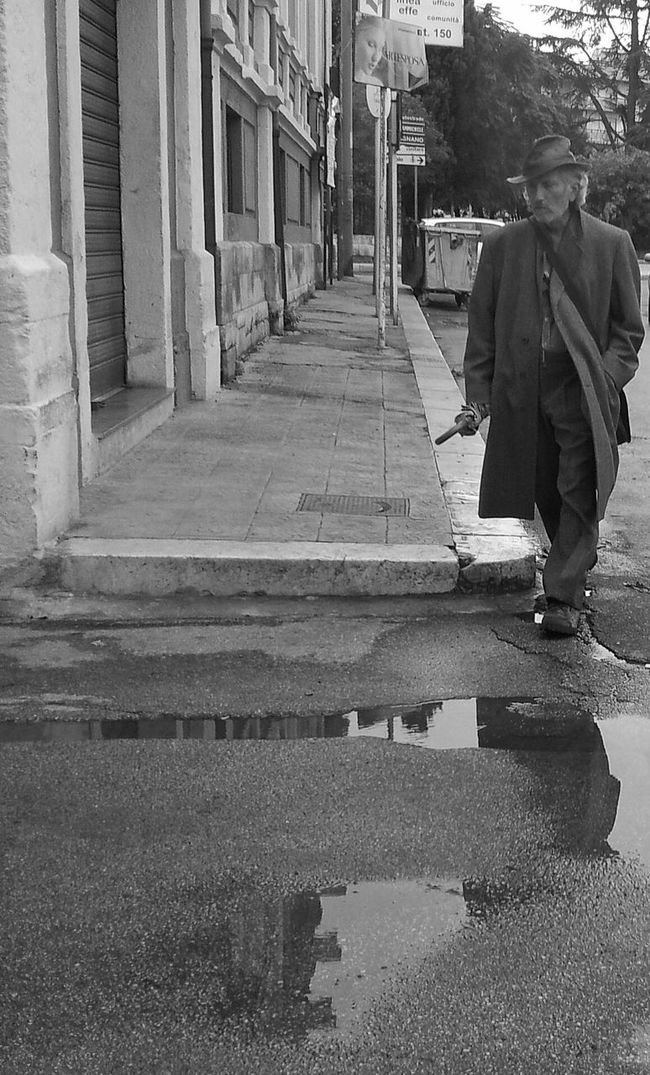 Rain man Black And White Streetphotography_bw StreetsWithPeople TheMinimals (less Edit Juxt Photography)