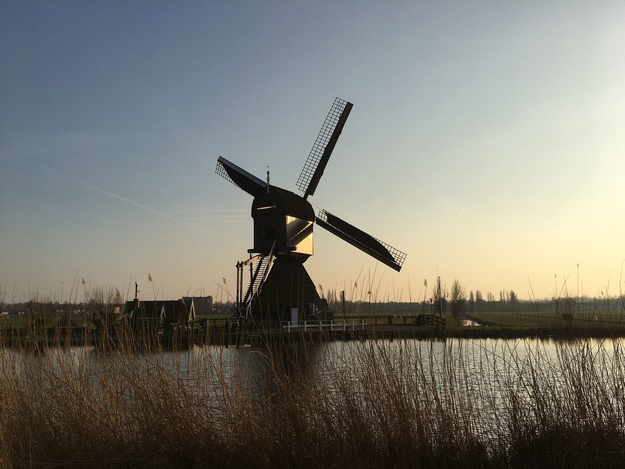 Alternative Energy Fuel And Power Generation Windmill Renewable Energy Traditional Windmill Wind Power Environmental Conservation Water Wind Turbine Nature Rural Scene Sky Sunset Beauty In Nature Lake Built Structure No People Reed - Grass Family Outdoors Architecture