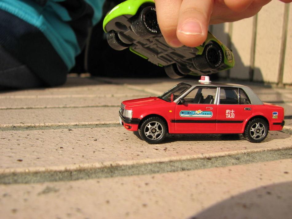 Close-up HongKong Taxi Playing With Toycar ToyCar