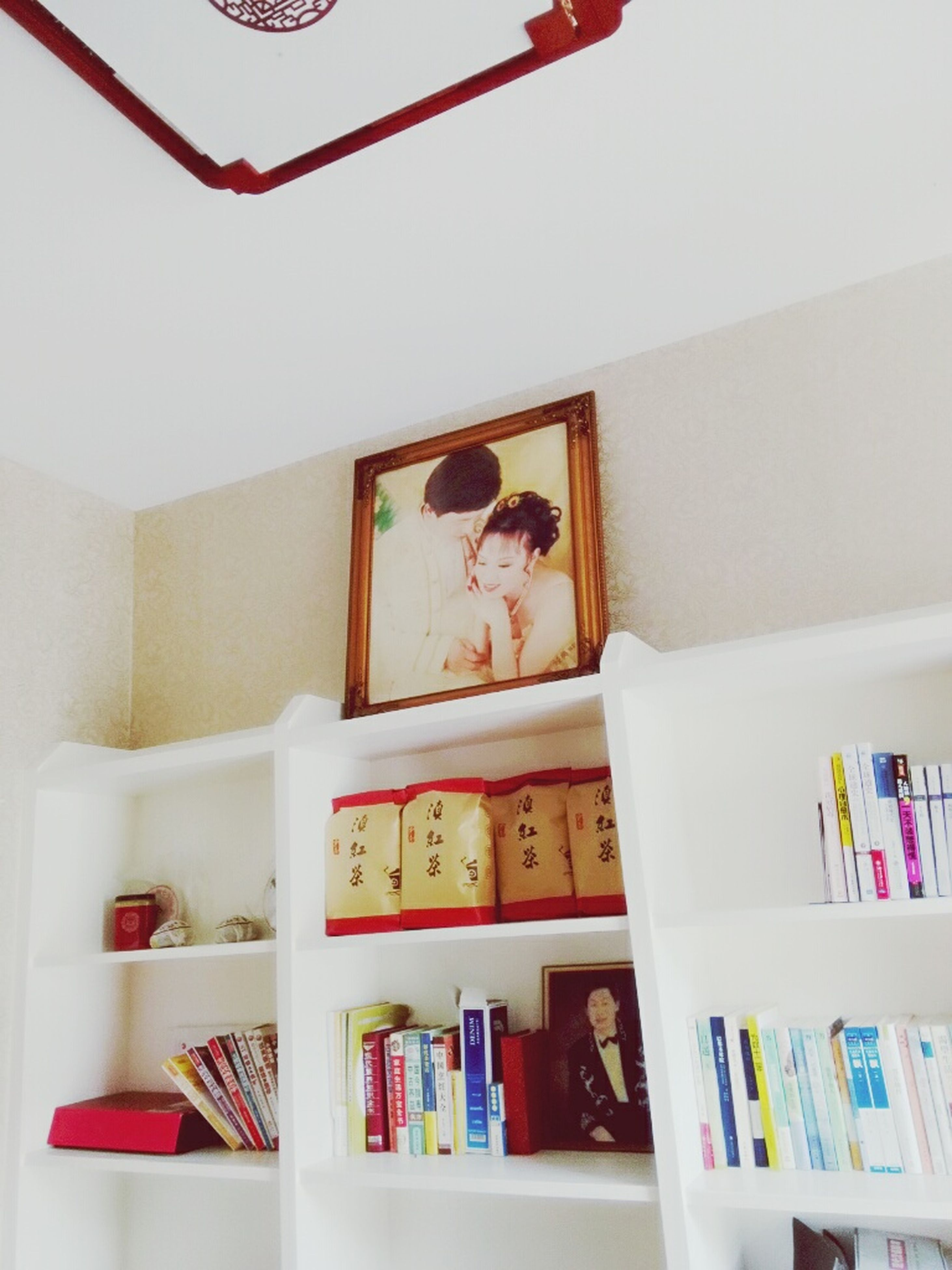 indoors, still life, variation, shelf, home interior, book, table, large group of objects, arrangement, education, choice, no people, paper, collection, multi colored, text, bed, pillow, picture frame, close-up