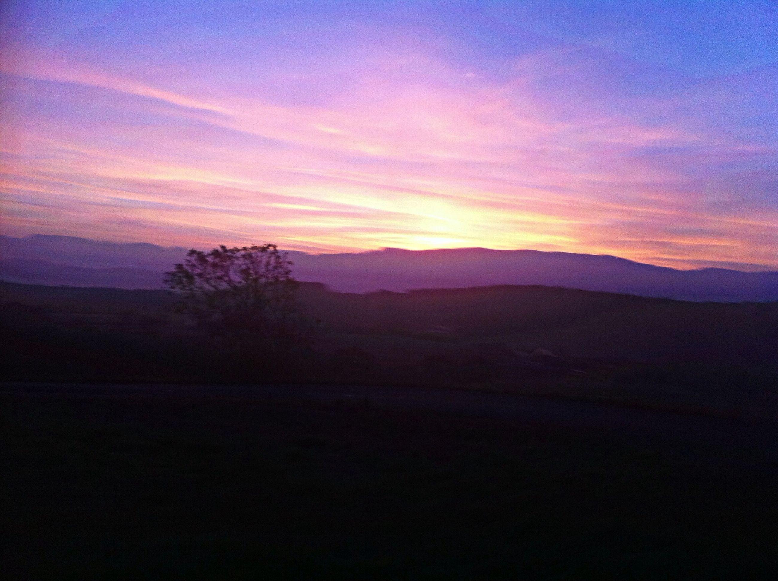 sunset, tranquil scene, scenics, tranquility, silhouette, mountain, beauty in nature, landscape, sky, mountain range, nature, idyllic, orange color, cloud - sky, non-urban scene, dusk, majestic, cloud, remote, dark