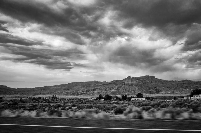 Arizona Big Sky Desert Driving Houses Poor  Barren Barren Landscape Cloud - Sky Clouds Drive-by Highway Landscape Mountain Nature Passing By Road Rural Scene Sky Trailer