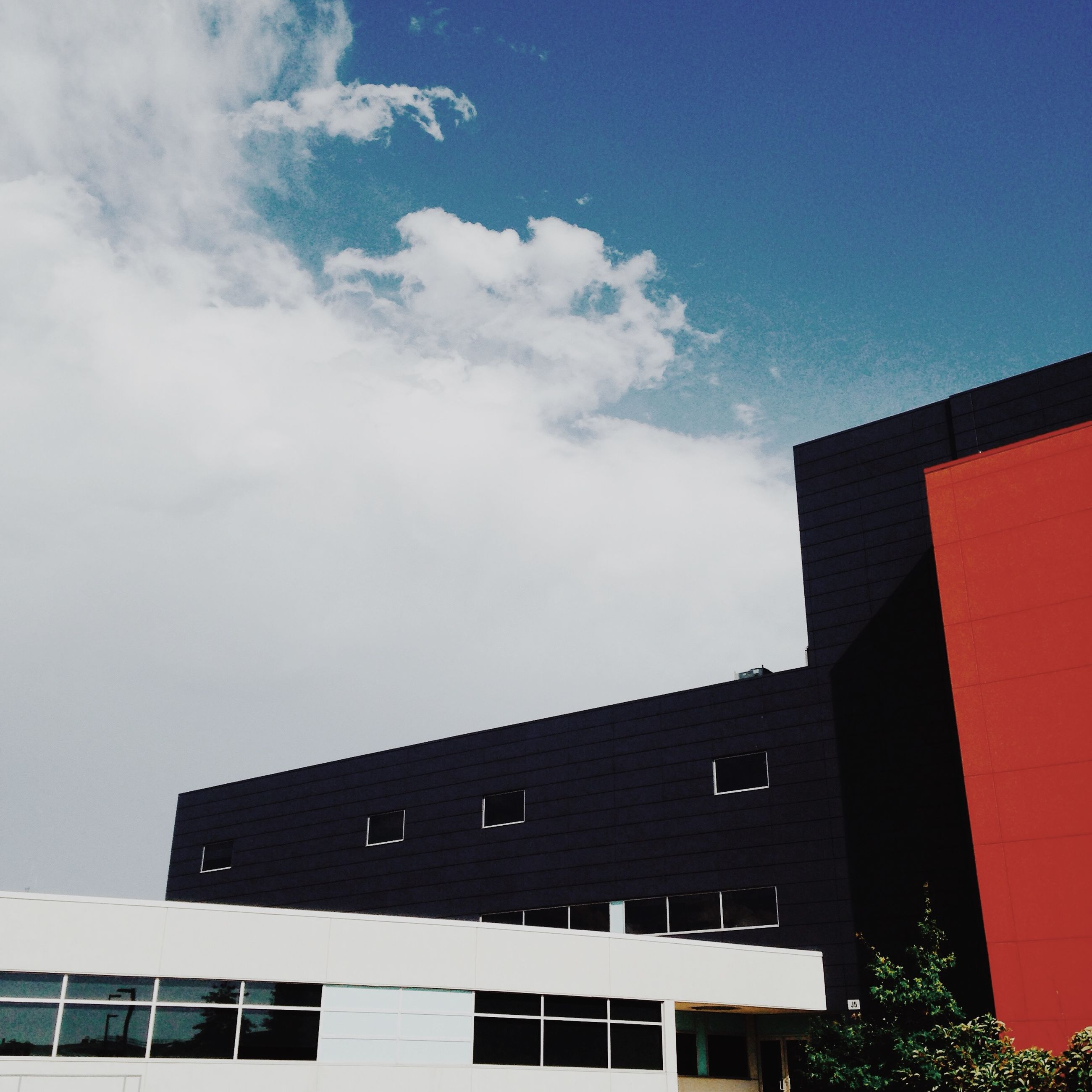 building exterior, architecture, built structure, low angle view, sky, residential structure, residential building, window, building, house, cloud - sky, city, high section, outdoors, day, no people, cloud, exterior, blue, cloudy