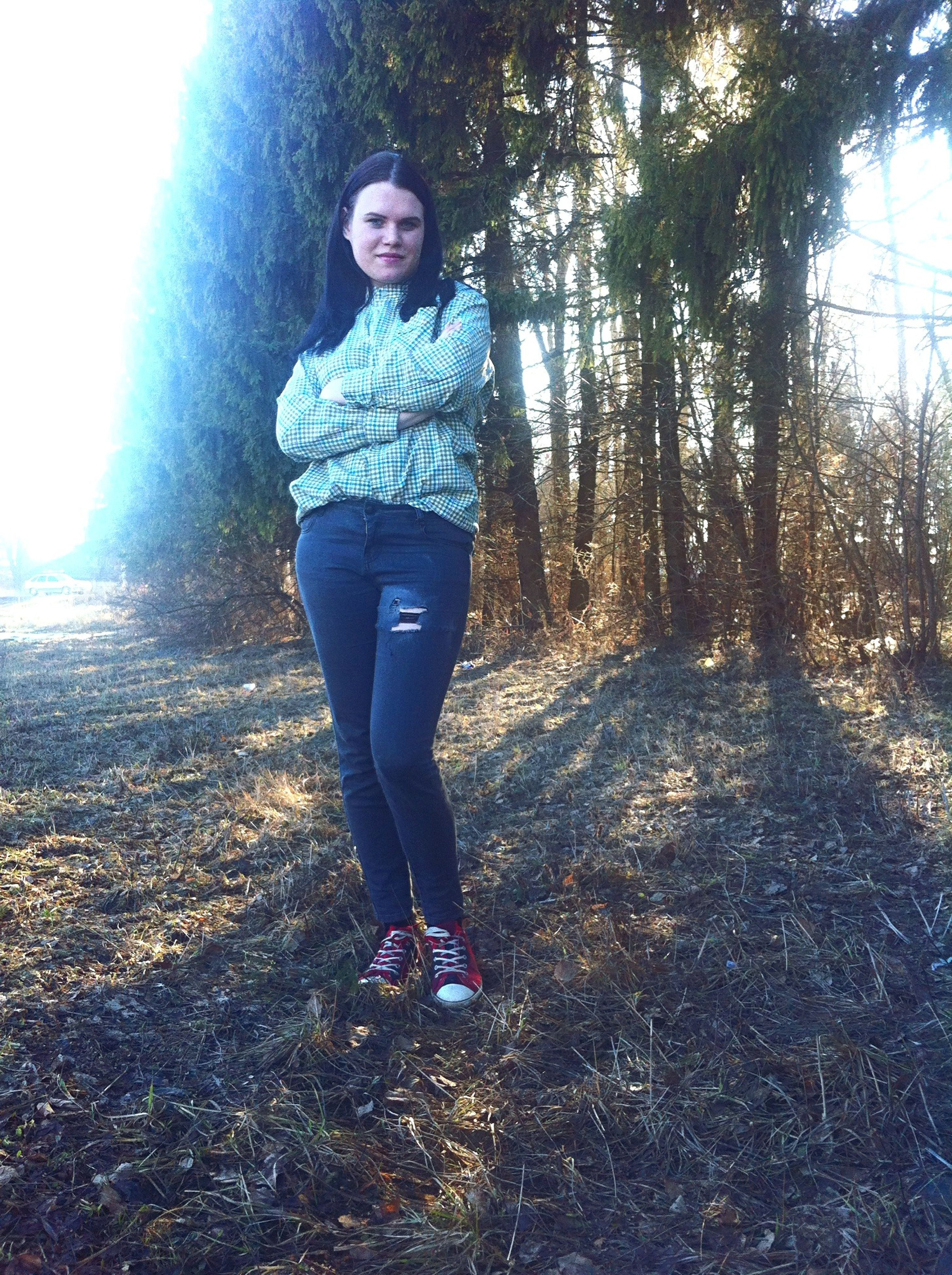 lifestyles, casual clothing, young adult, full length, leisure activity, person, standing, front view, looking at camera, portrait, young women, tree, nature, forest, smiling, warm clothing, three quarter length, day