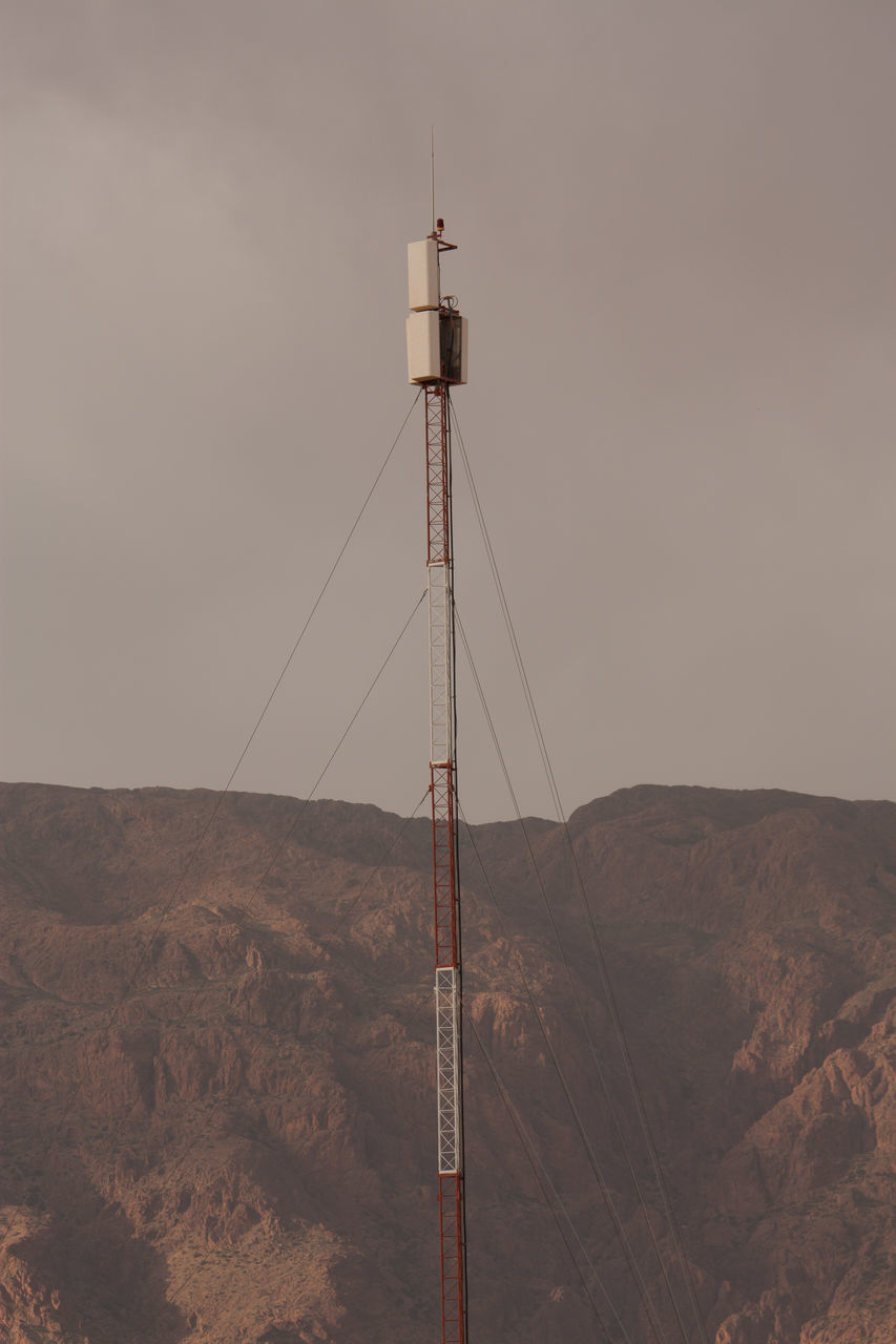 Communications Tower With Mountain In The Background