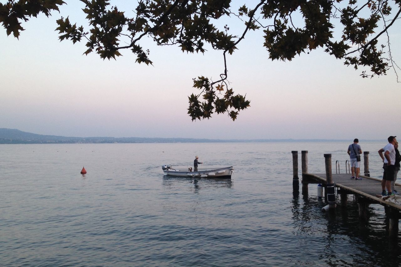 nature, water, tree, beauty in nature, real people, scenics, outdoors, sea, men, sunset, sky, nautical vessel, day, people