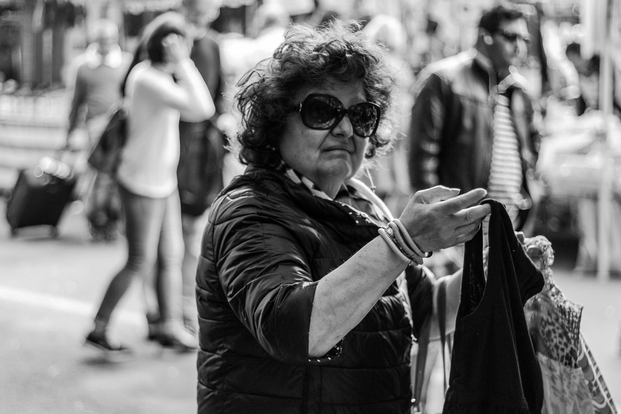 why so serious? Don't ask me man...i just work here... Black & White Blackandwhite Blackandwhite Photography Buying Don't Ask Me Man...I Just Work Here... People Photography Porta Portese Streetphotography The Street Photographer - 2016 EyeEm Awards Woman Portrait