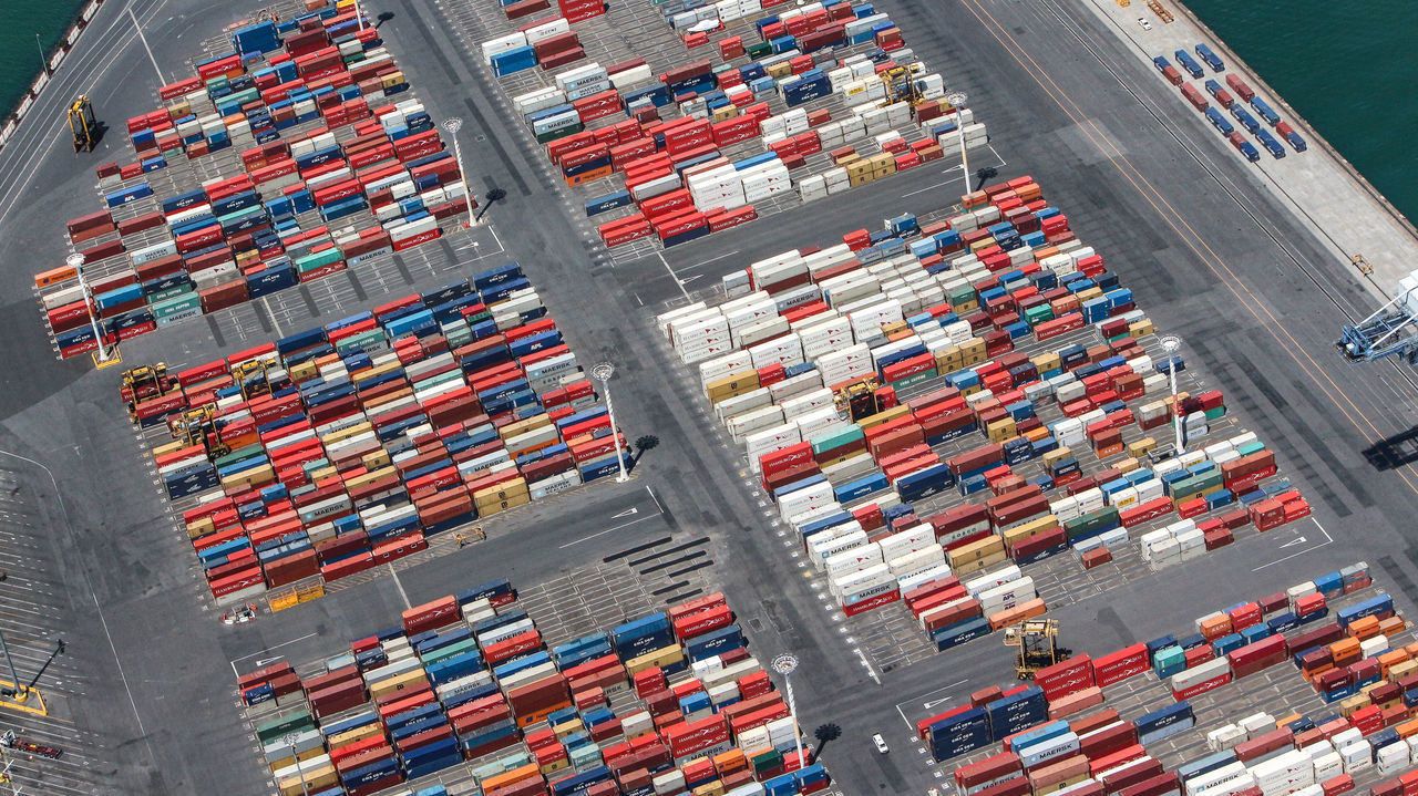 freight transportation, shipping, cargo container, industry, container, commercial dock, large group of objects, transportation, aerial view, harbor, equipment, trucking, high angle view, business, stack, nautical vessel, delivering, distribution warehouse, day, warehouse, shipyard, no people, outdoors, nautical equipment