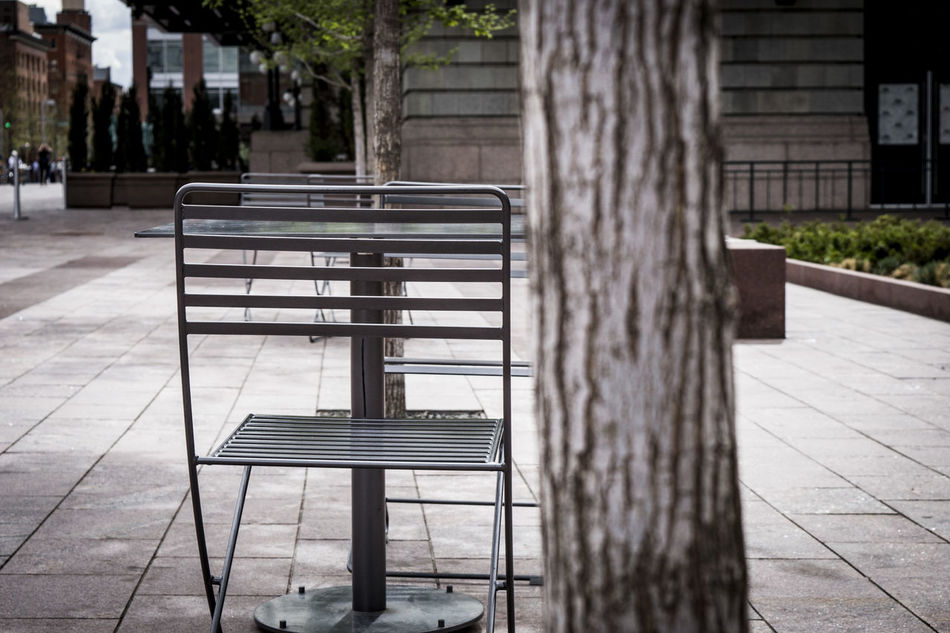 Absence Architectural Column Architecture Built Structure Chairs And Tables City City Life Day Empty Empty Chair Empty Seat Footpath In A Row No People Outdoors Repetition Sunlight Travel Destinations Tree Tree Trunk Walkway