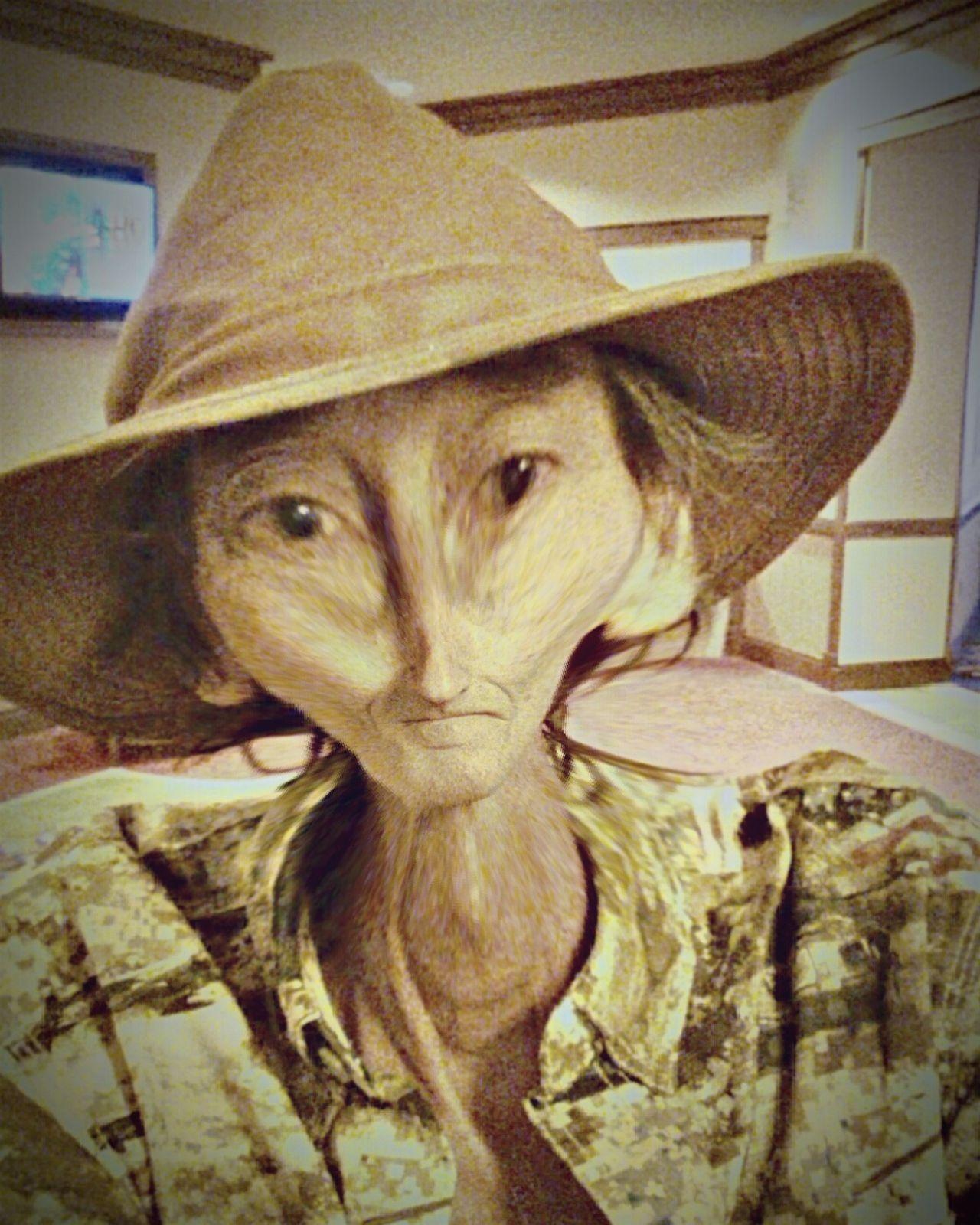Alian in hat.