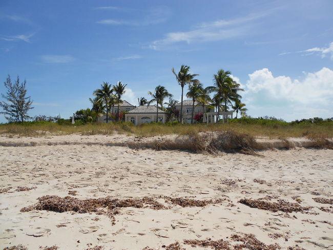 Beach House Turks And Caicos Turks And Caicos Islands Carabbean Seashore Palm Trees Sand Chalet Paradise Screensaver Travel Traveling