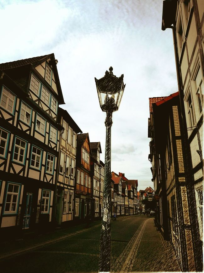 City Lighting Equipment The Way Forward Building Exterior Architecture Built Structure Lamp Post Footpath City Street City Life History Cloud Long Outdoors Residential Building Street Street Light Building Day Sky Cobblestone