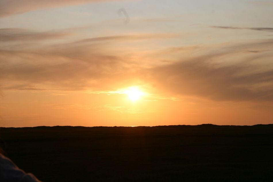 Beauty In Nature Cloud Cloud - Sky Dark Horizon Over Land Idyllic Landscape Majestic Nature No People Non-urban Scene Orange Color Outdoors Remote Scenics Sky St.Peter-Ording Germany Sun Sunbeam Sunset Tranquil Scene Tranquility