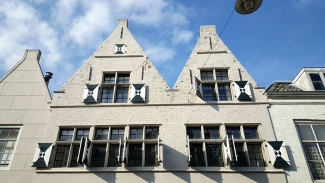 Architecture Window Built Structure Low Angle View Building Exterior Sky Cloud Day In A Row Cloud - Sky Blue Outdoors Repetition Architectural Feature No People Taking Pictures Taking Photos Dutch Cities Amazing Architecture Dutch Dutch House Dutch Architecture Dutch Photographer Houses Architecture_collection