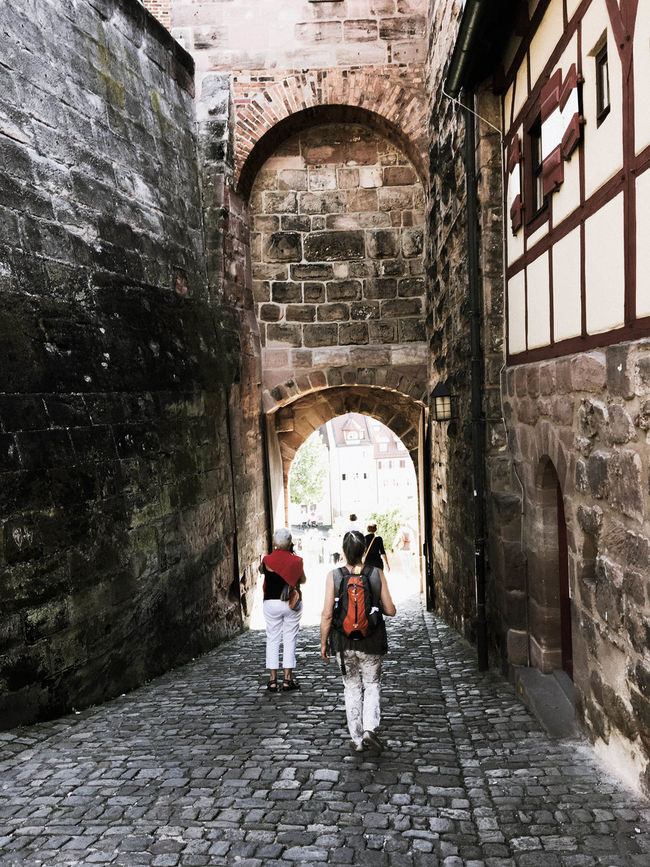 Arch Arched Architecture Archway Building Exterior Built Structure Castle Casual Clothing Day Entrance Germany History Nürnberg Outdoors Person Window