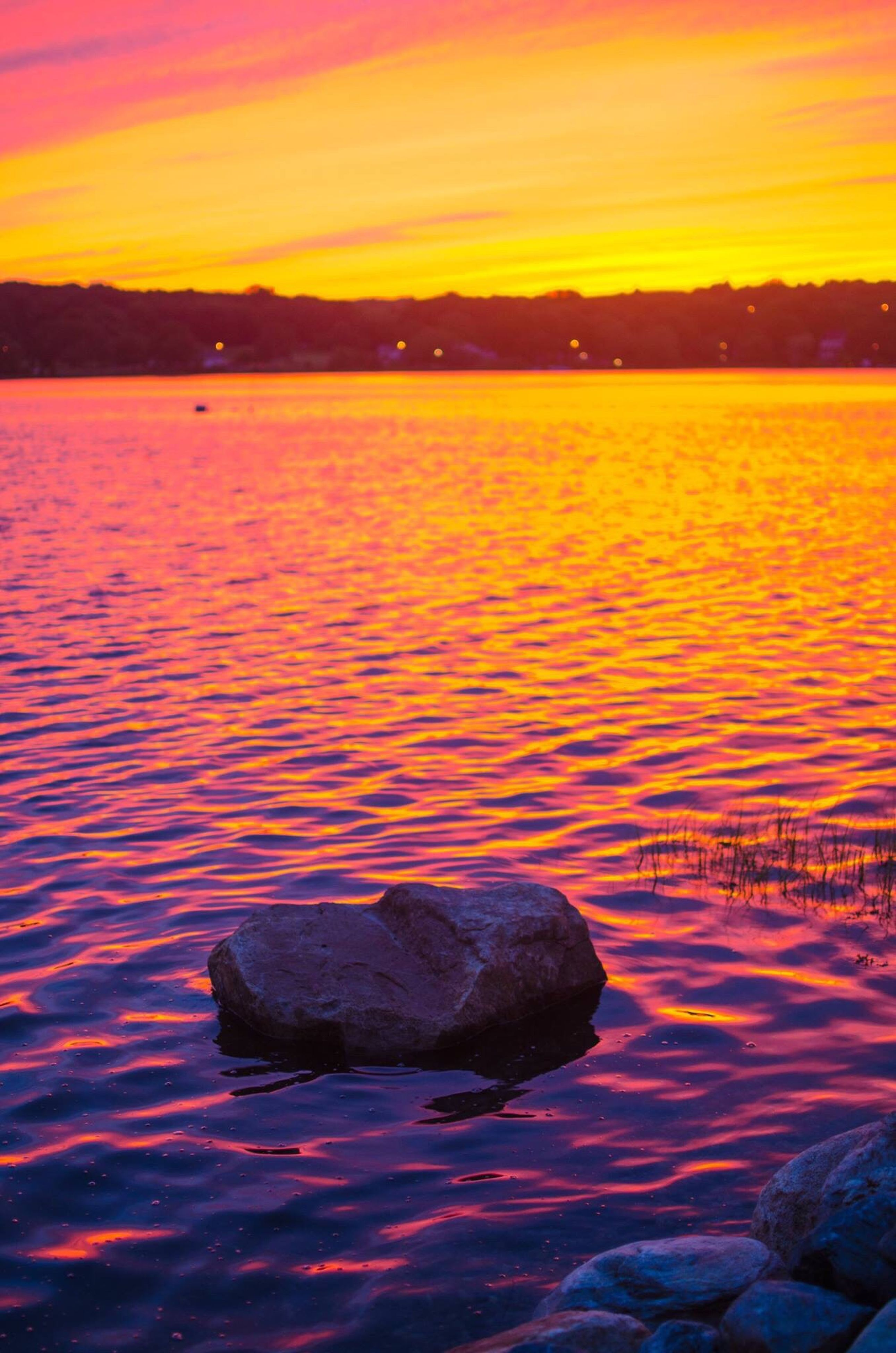 sunset, water, scenics, tranquil scene, tranquility, beauty in nature, sea, waterfront, rock - object, majestic, island, nature, rippled, idyllic, sky, orange color, travel destinations, cloud - sky, water surface, non-urban scene, ocean, seascape, mountain, outdoors, no people, vacations, tourism, romantic sky, shore