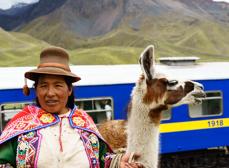 Human Meets Technology America Anden Cusco Women Who Inspire You Express High Historical Sights International Landmark Up Close Street Photography Lama Music Old People Peru Peru Rail Puno Rail South Traditional Train Train Tracks Travel Showcase March Telling Stories Differently