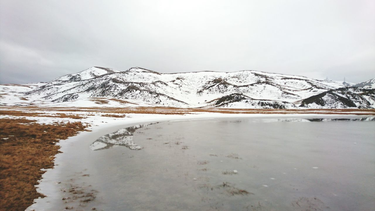 Nature Water Landscape No People Outdoors Cold Temperature Sky Day Frozen Lake Mountain Lake Mountains Grey Day Wintertime Winter Snow Snow ❄ Rain Ice Lake Frozen Winter Reflection