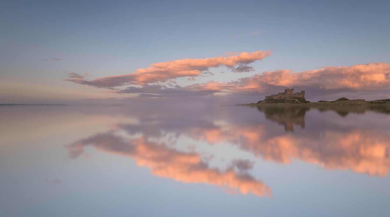 Mirror Mirror Reflection Water Sky Waterfront Nature Sunset No People Idyllic Beauty In Nature Lake Tranquil Scene Scenics Tranquility Cloud - Sky Outdoors Day Castle Sea And Sky Seascape Blue & Pink Creative Edit Bamburgh Northumberland Symmetry Mirror