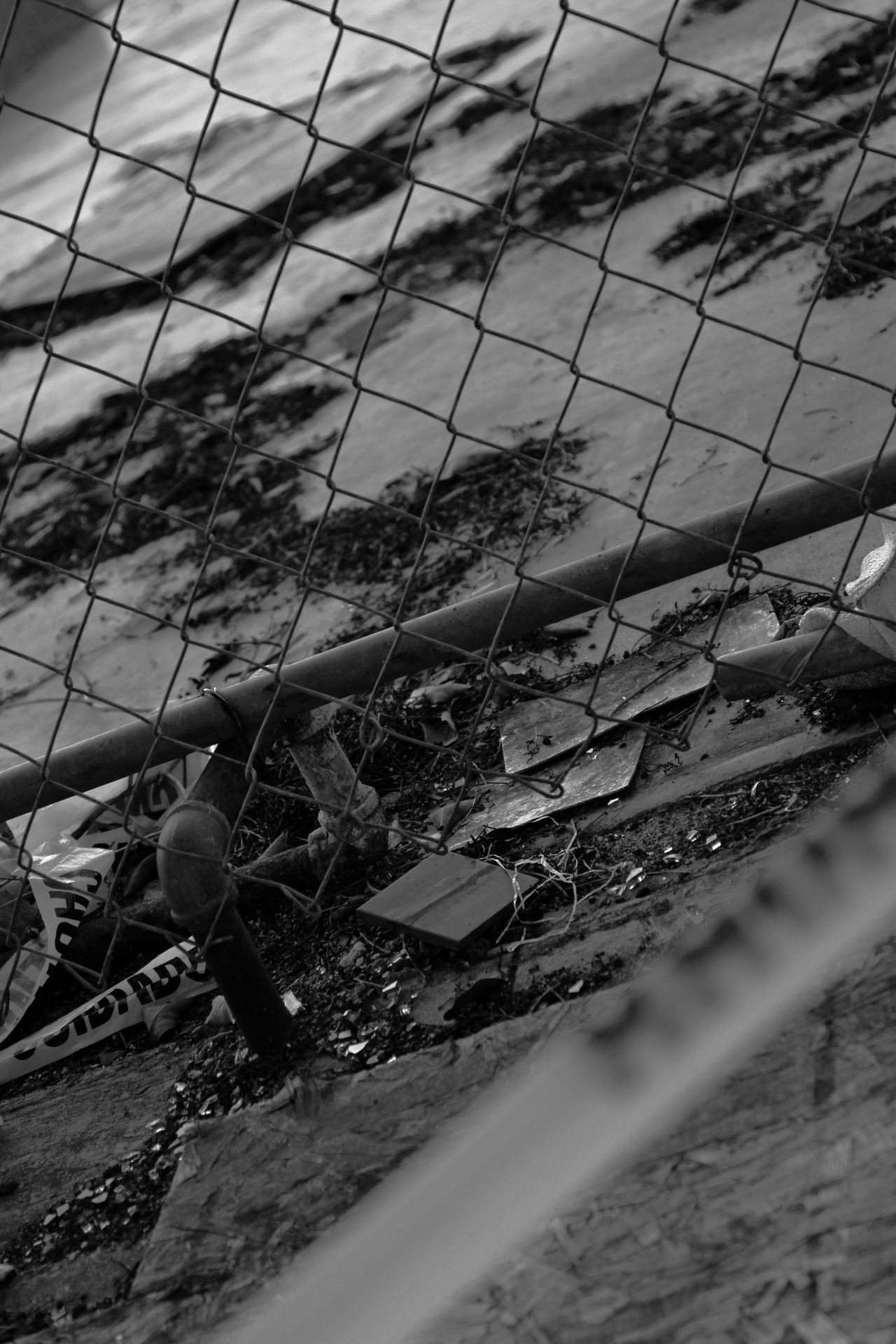 After The Fire Behind Yellow Tape Black & White Chain Link