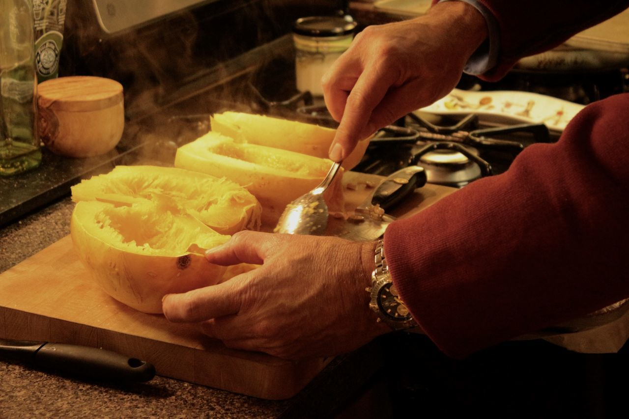 Cropped Image Of Hand Preparing Food In Kitchen