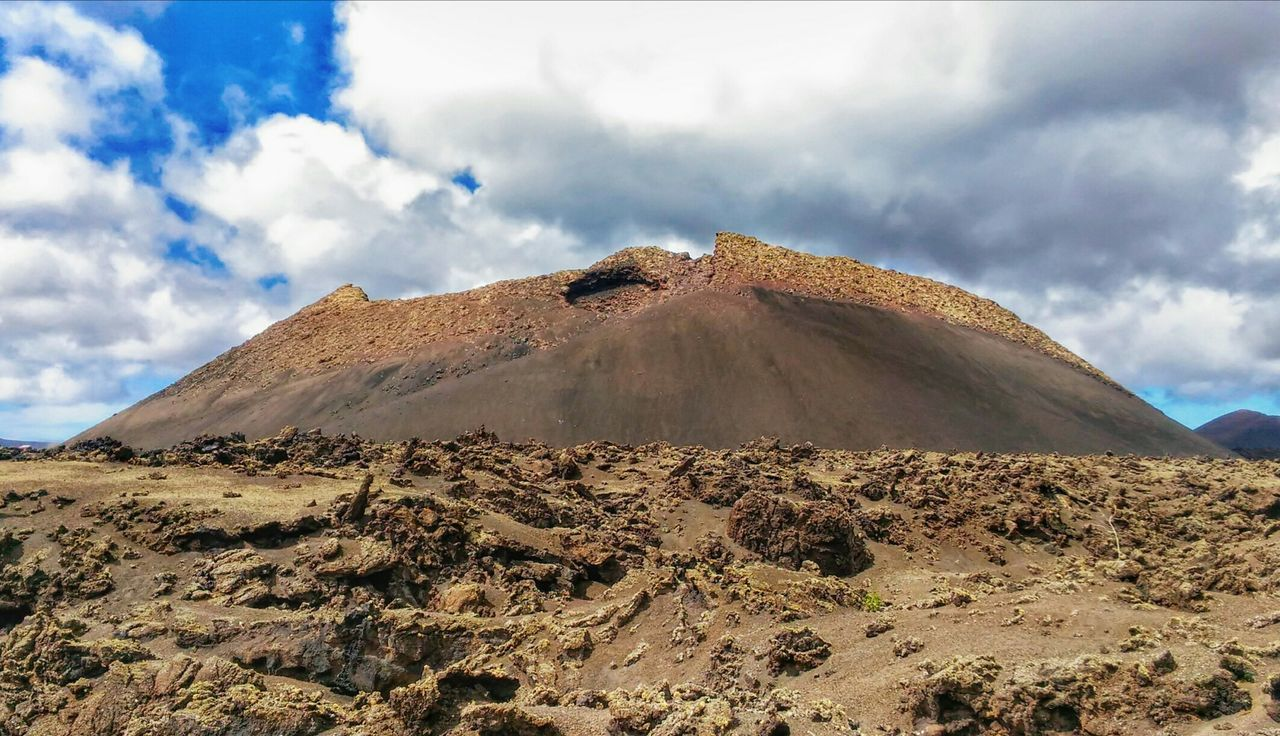 sky, cloud - sky, geology, landscape, nature, arid climate, desert, tranquil scene, tranquility, scenics, beauty in nature, physical geography, day, outdoors, volcanic landscape, no people, mountain