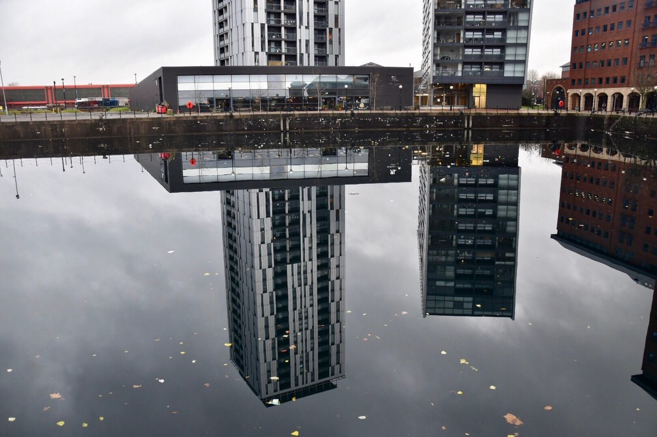 Urban reflections. Built Structure Architecture Building Exterior Reflection City Sky Tall - High Tower Cloud - Sky Waterfront Outdoors Skyscraper Urban Landscape Architecture Reflections EyeEm Gallery Water Day No People Urban Skyline City Gate EyeEm Best Shots Reflections In The Water Getty X EyeEm Urban Reflections