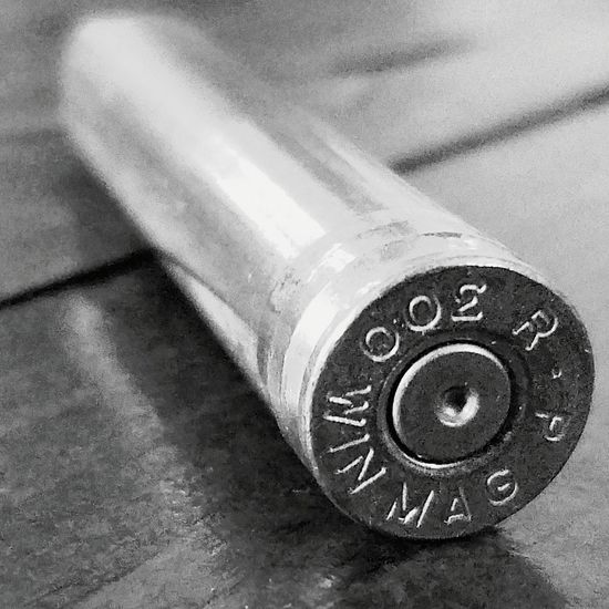 Table Indoors  No People Close-up Day Scenesofthesouth Projectile Brass Metal Hunting Gun Violence Shooting 300 Winchester Casing Bullet Cyclinder Blackandwhite
