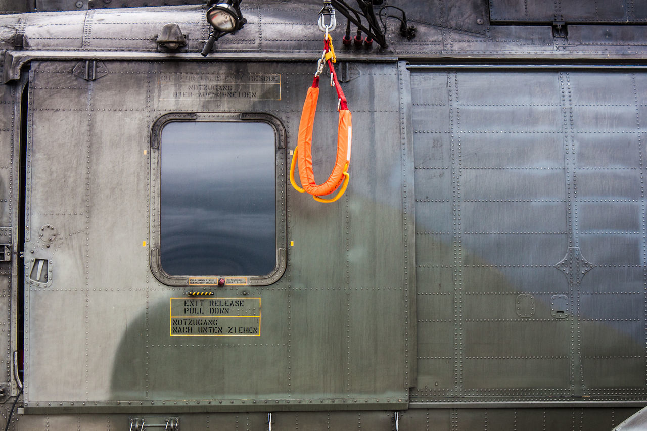 Air Vehicle Aircraft Cable Winch Close-up Day Detail Door Hanging Helicopter No People Orange Color Outdoors Search And Rescue Transportation Wind Gear