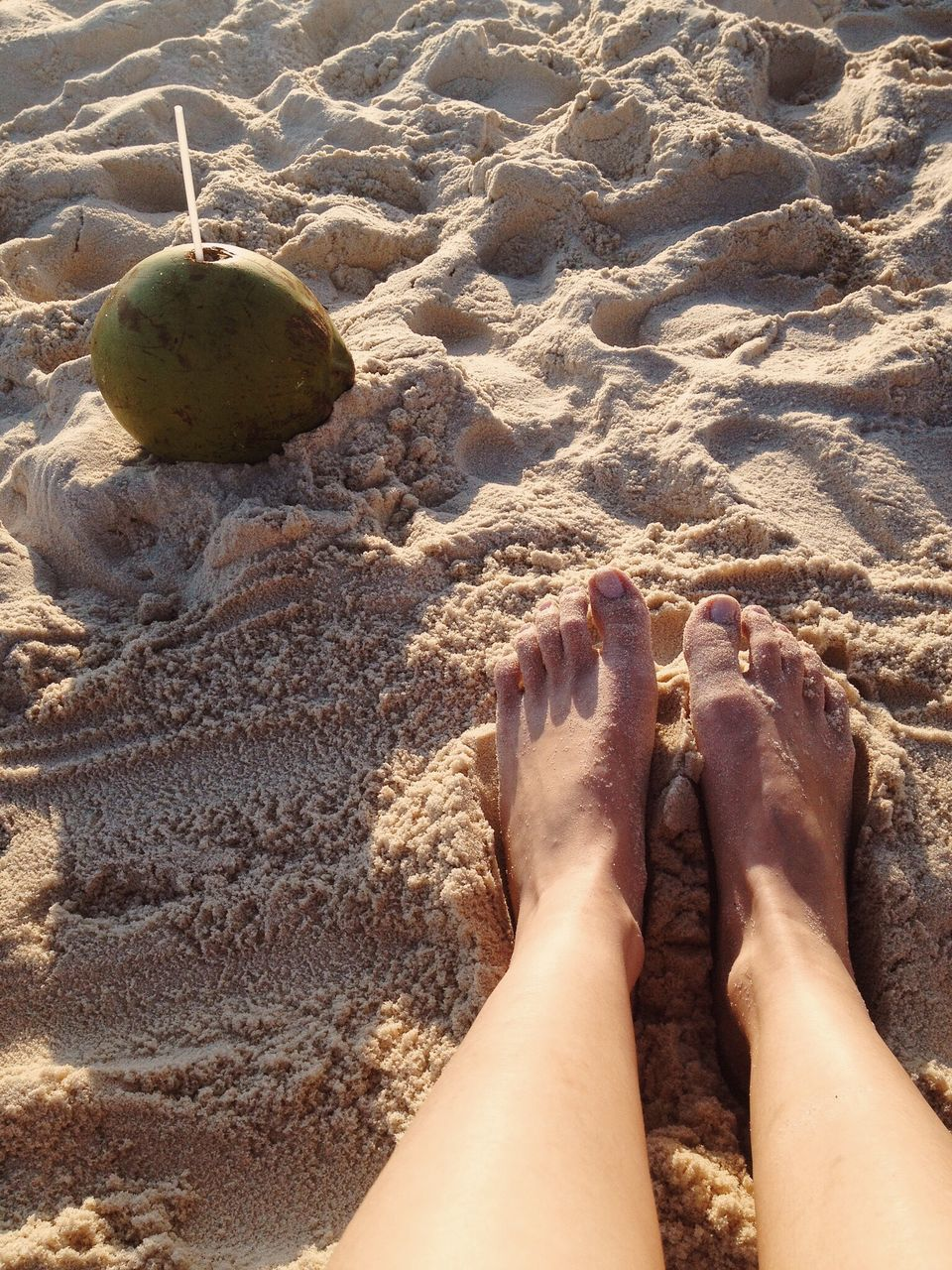 sand, beach, human leg, barefoot, low section, shore, real people, human foot, day, personal perspective, outdoors, one person, sunlight, high angle view, nature, leisure activity, human body part, vacations, women, sea, water, close-up