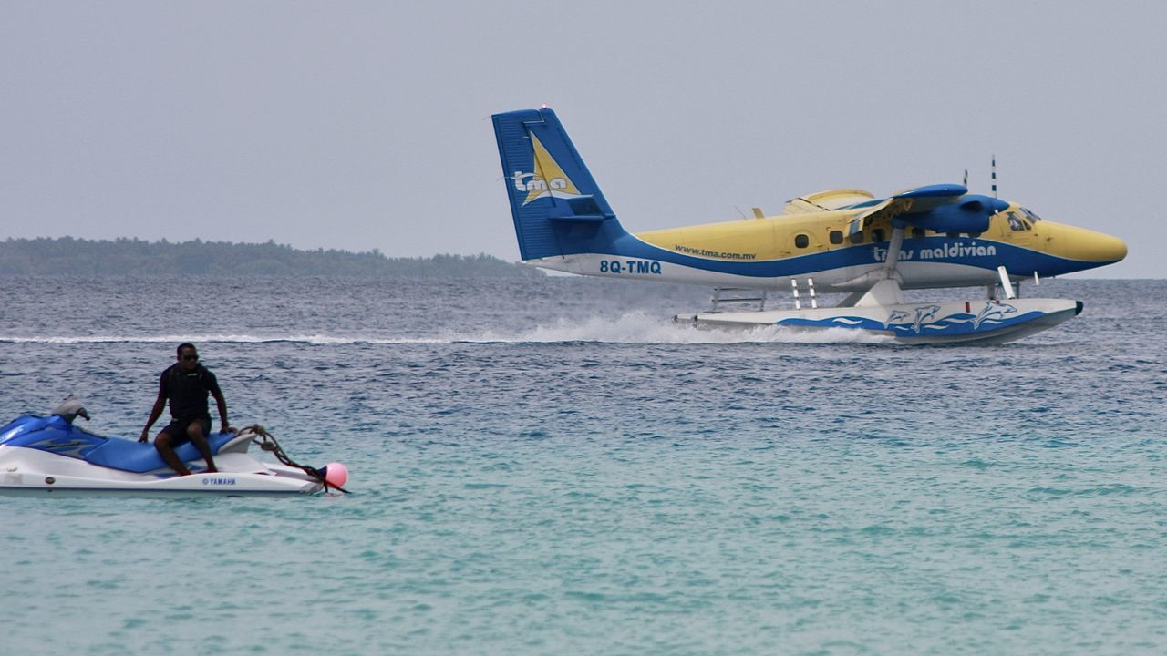 water airplane landing on blue sea, maldives Adventure Airplane Beauty In Nature Flying Holiday Journey Landing Leisure Activity Lifestyles Light Men Nature Ocean Outdoors People Real People Sea Sky Transportation Travel Two People Vacations Water Let's Go. Together.