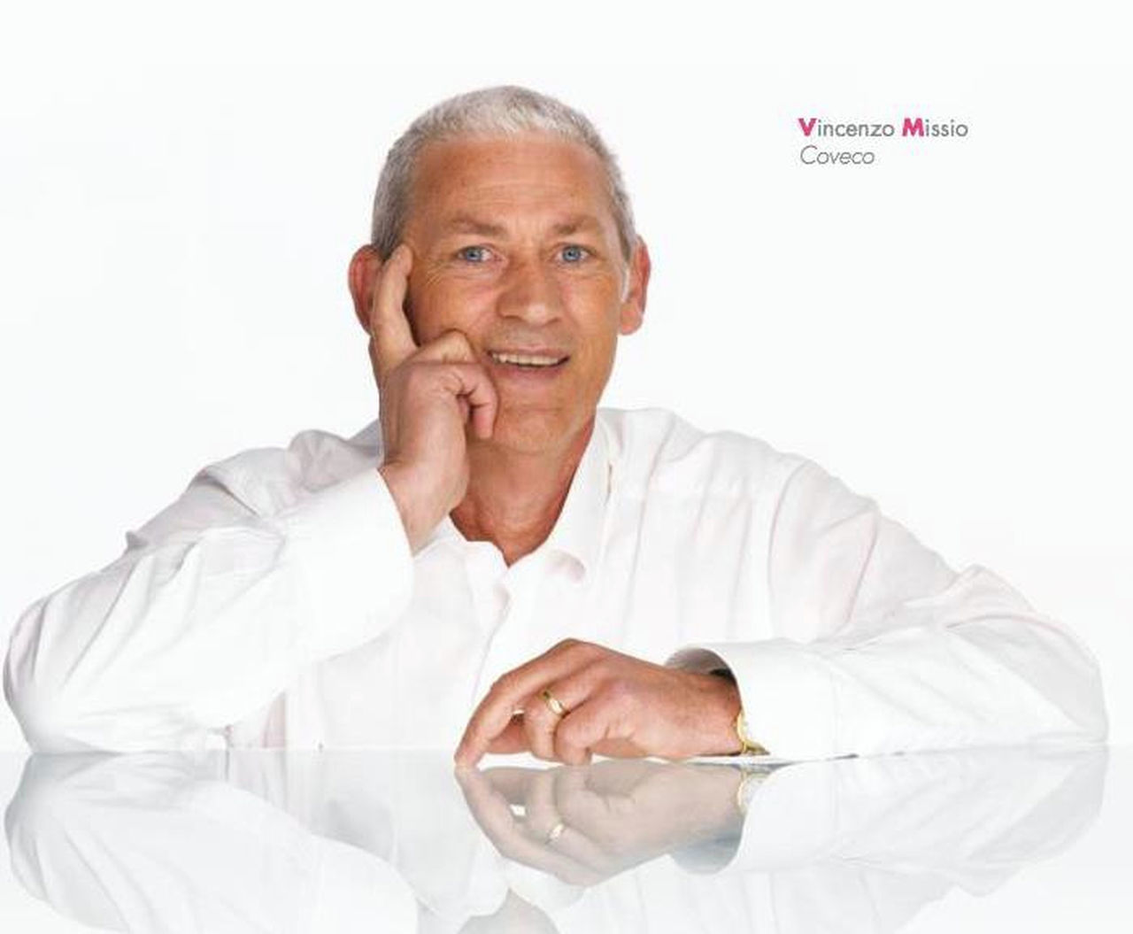 senior adult, one man only, only men, one person, one senior man only, white background, adults only, adult, senior men, men, people, gray hair, human body part, holding, technology, sitting, businessman, indoors, wireless technology, human hand, portrait