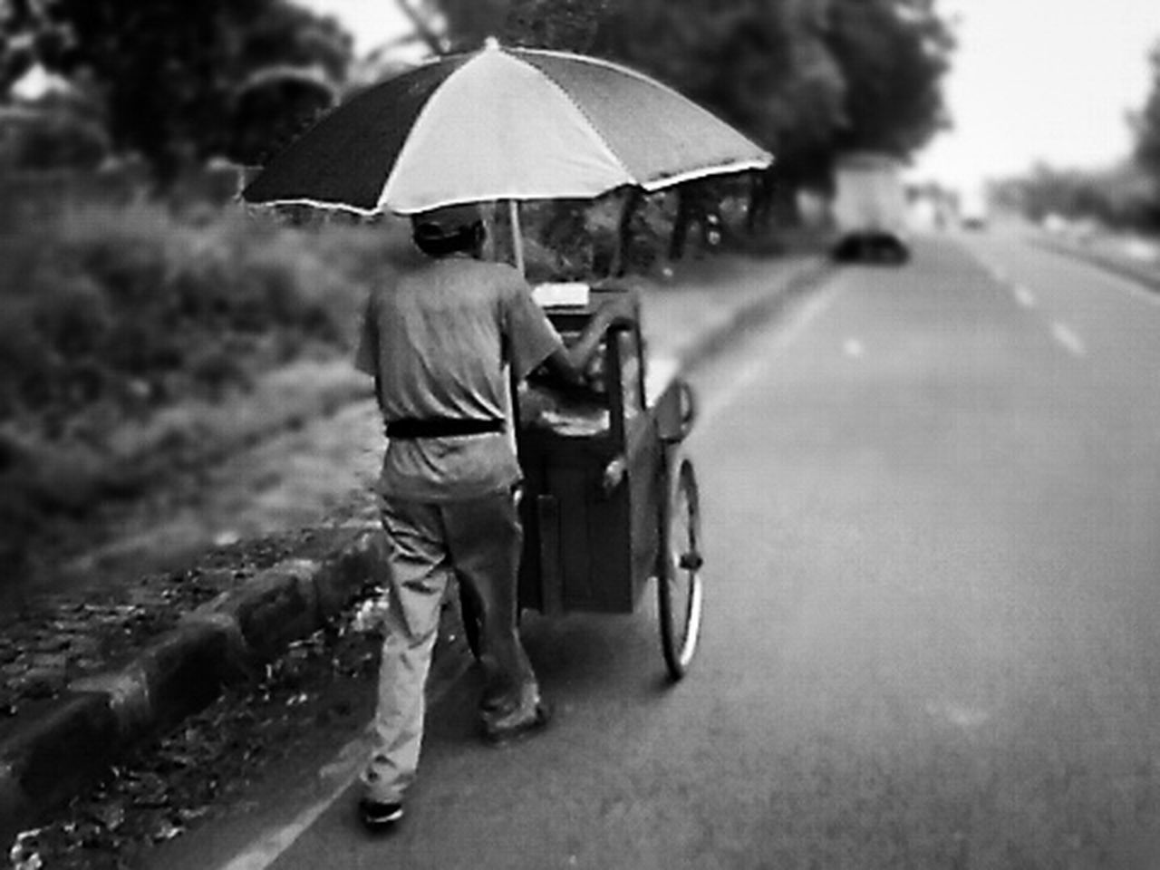 This is the real hero,everyday, every hour he struggled to change the pain into power, the power to make money so that his family can live Real People Rear View Road Walking Outdoors Low Angle View Streetphotography Black And White Oldman Real Photography Real Life Realhero