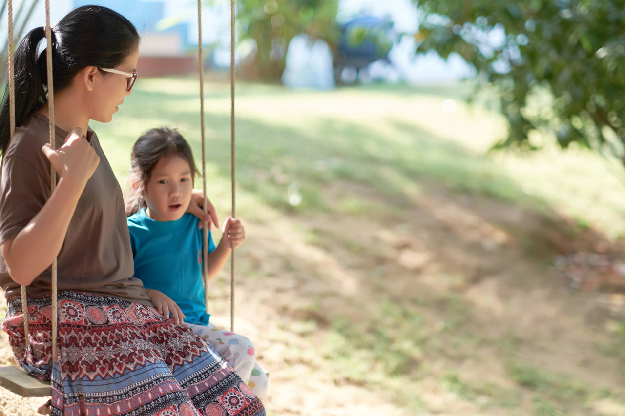 Adult Baby Bonding Child Childhood Day Family Females Girls Happiness Human Body Part Leisure Activity Mother And Daughter Nature Outdoors People Portrait Smiling Summer Swing Togetherness Two People Unity