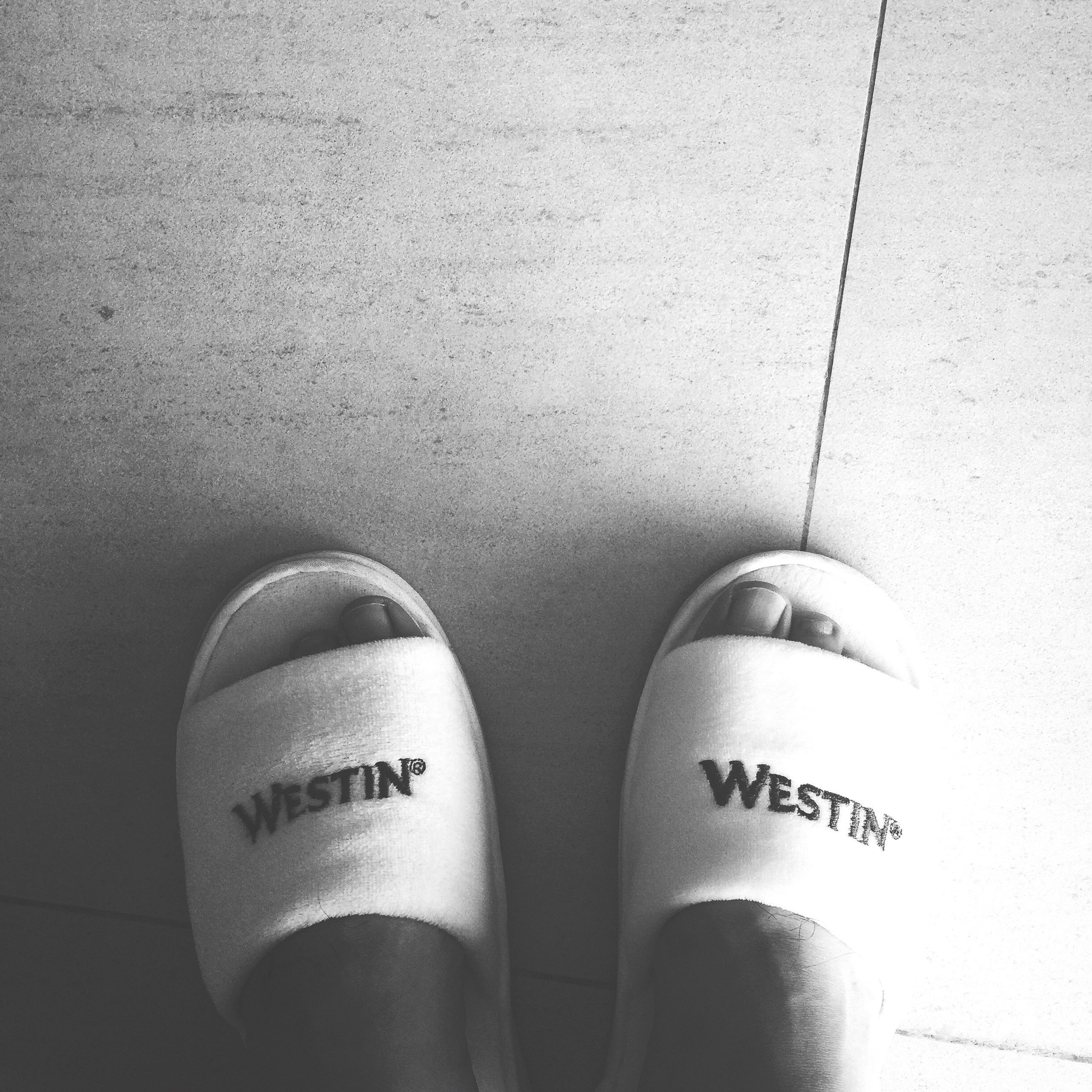 low section, person, personal perspective, shoe, footwear, human foot, indoors, high angle view, part of, white color, directly above, lifestyles, close-up, standing, text, communication, leisure activity