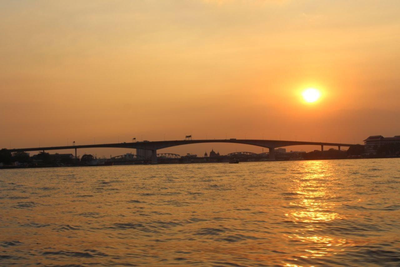 bridge - man made structure, sunset, connection, engineering, architecture, water, river, built structure, sun, sky, transportation, bridge, waterfront, nature, no people, outdoors, suspension bridge, travel destinations, scenics, city, clear sky, beauty in nature, day