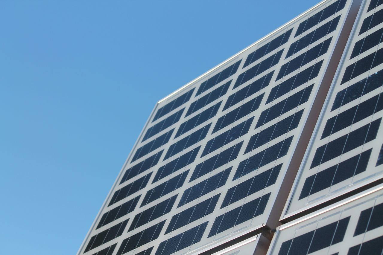 Low Angle View Of Solar Panels Against Blue Sky