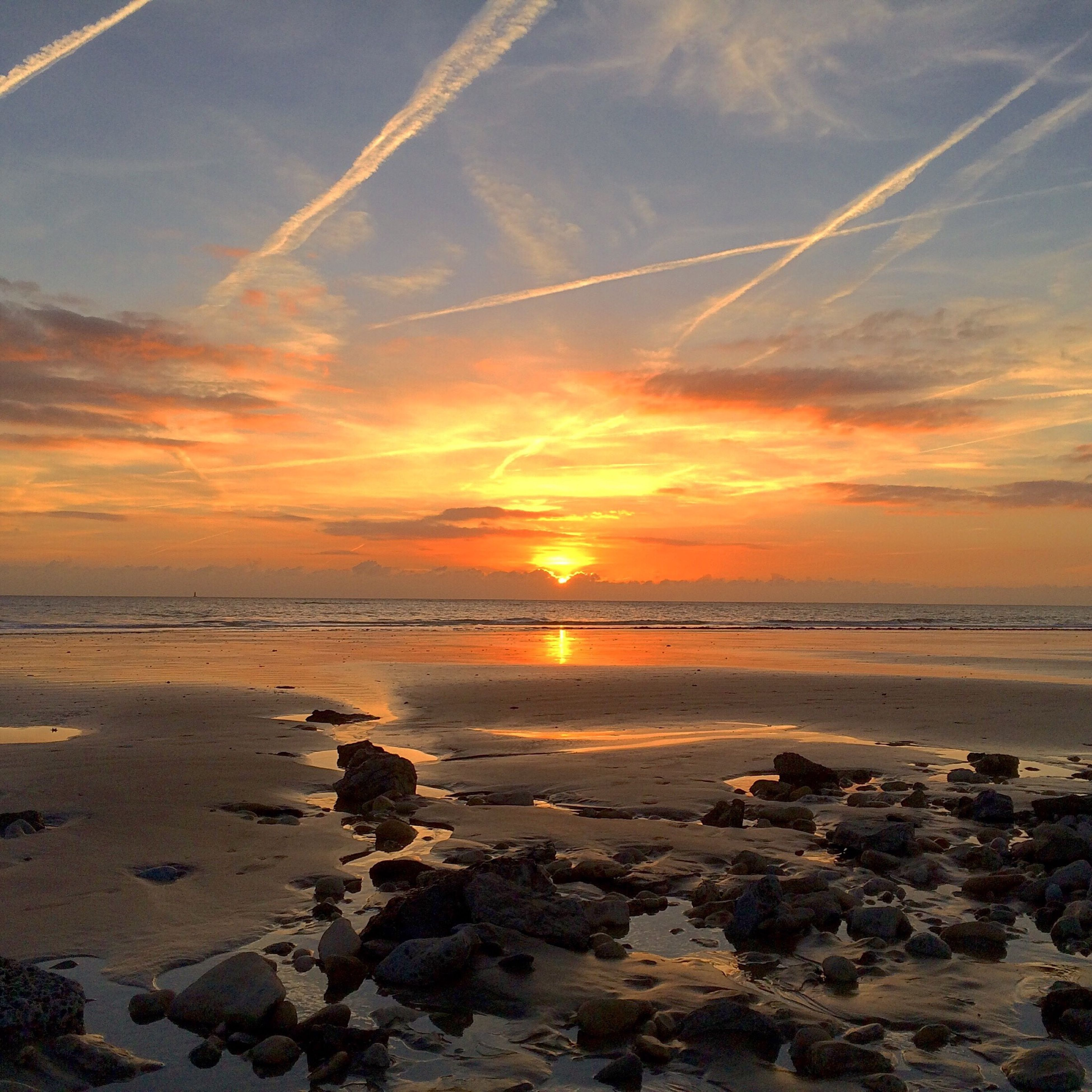 sunset, water, scenics, beach, tranquil scene, sea, beauty in nature, tranquility, sky, shore, sun, horizon over water, orange color, nature, idyllic, cloud - sky, reflection, rock - object, sunlight, non-urban scene