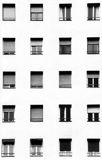 Porque a veces nos observan desde sus nichos de luciernagas. Window Building Exterior Architecture Residential Building Built Structure Façade Lifestyles Apartment No People Day City Black And White Photography Canon_official Abstract Photography Canon Sx50 Filter Photooftheday Photography Medellin City