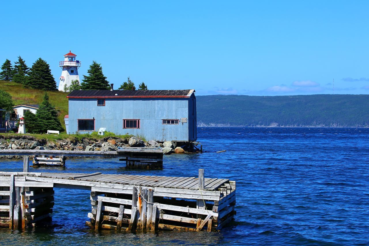 Woody Point Lightstation Architecture Beauty In Nature Blue Blue House Clear Sky Day Fisherman's Cottage Jetty Landing Stage Lighthouse Nature No People Outdoors Pier Quay Scenics Sea Sky Tranquil Scene Tranquility Warehouse Water Waterfront Wooden House Wooden Lighthouse EyeEmNewHere