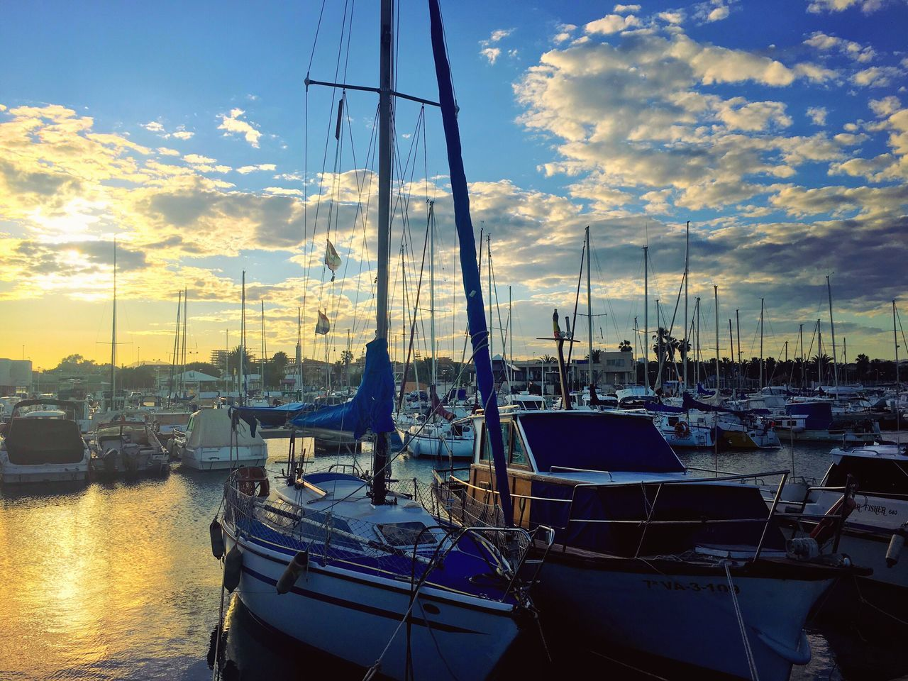 nautical vessel, moored, transportation, mode of transport, sky, boat, harbor, water, no people, cloud - sky, reflection, mast, marina, sunset, travel destinations, outdoors, sailboat, sea, waterfront, yacht, nature, day