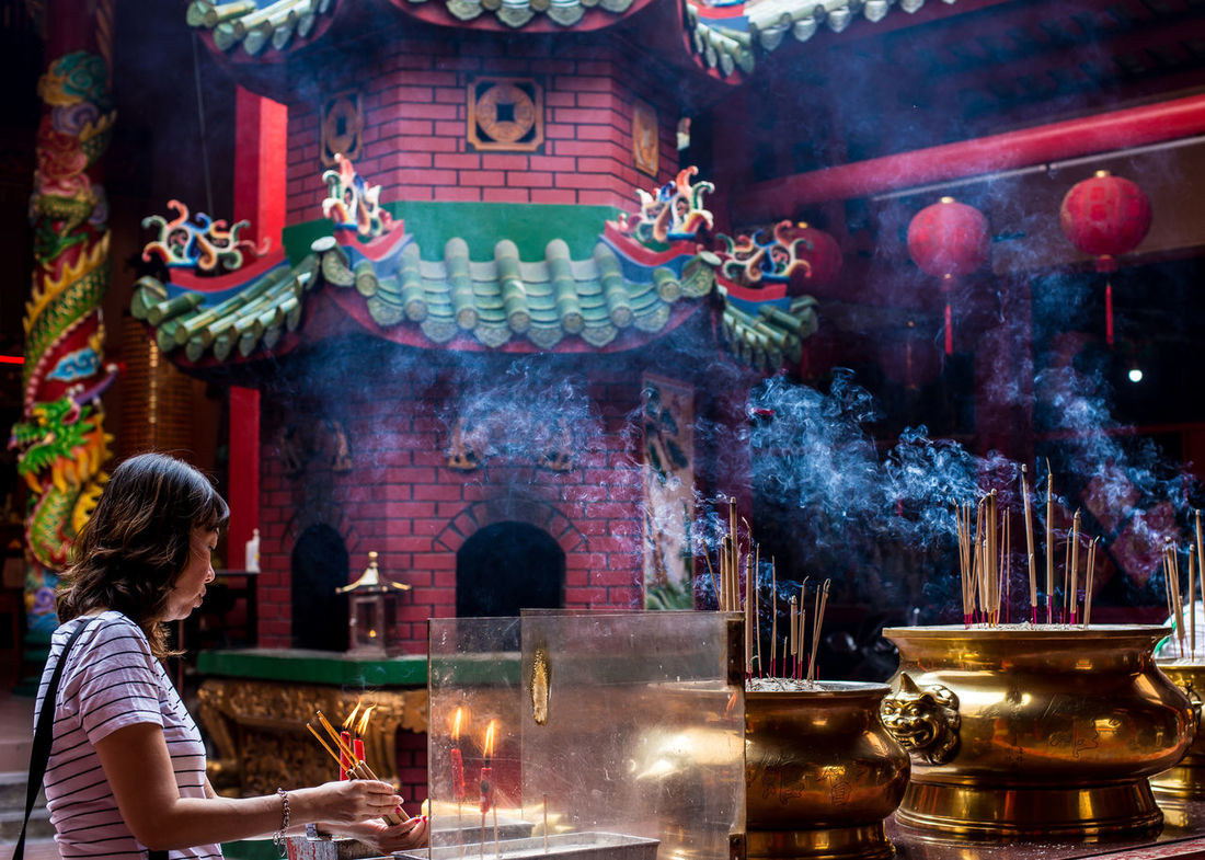 Chinese Woman lighting up her incense stick Altar EyeEm Best Shots Faith Kuala Lumpur Lantern Red Smoke Taoist Tourist Tourist Attraction  Travel Adult Adults Only Belief Burning Chinese Eyeem People Flame Incense Incense Sticks Indoors  Jostick Malaysia Night One Person One Woman Only People Place Of Worship Praying Religion Smoke - Physical Structure Spirituality Street Photography Table Taoim Temple Travel Destinations