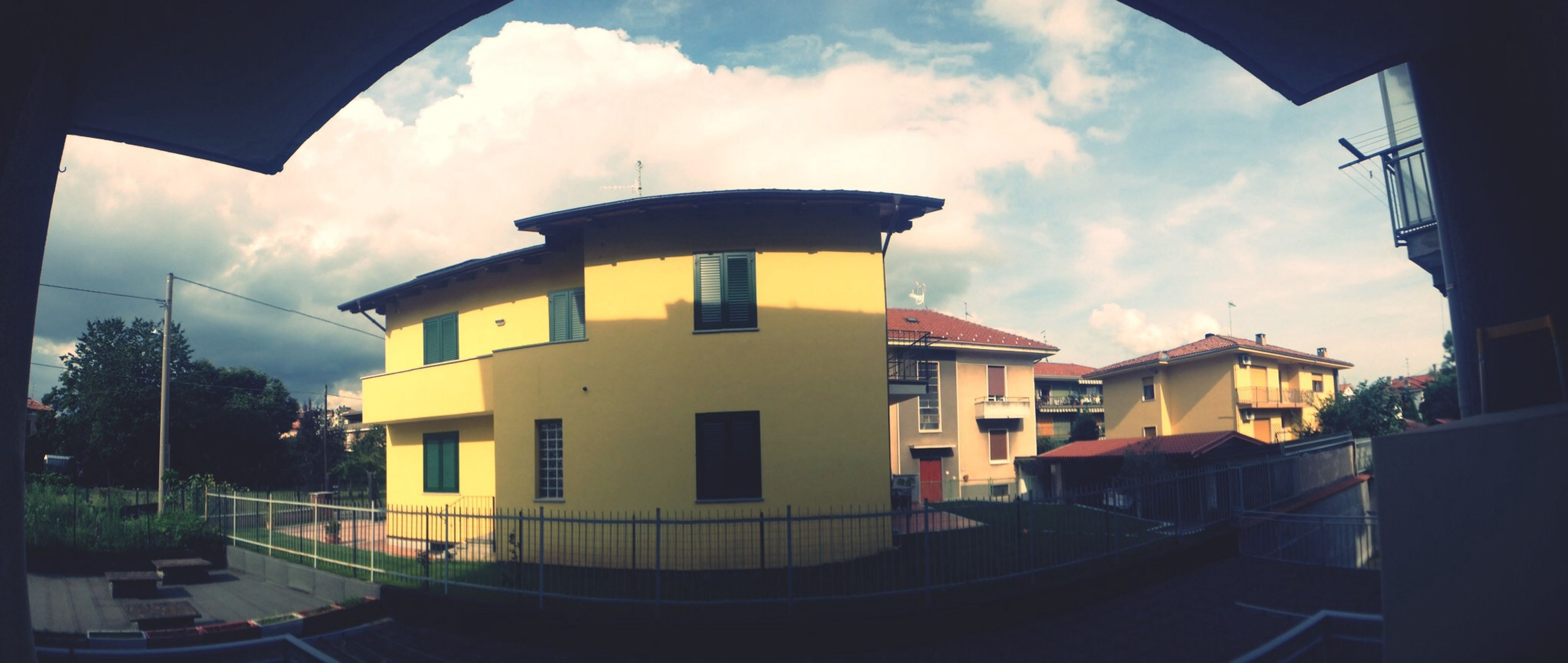 architecture, building exterior, built structure, sky, cloud - sky, house, residential structure, residential building, cloud, building, window, cloudy, transportation, city, outdoors, no people, low angle view, day, sunlight, auto post production filter
