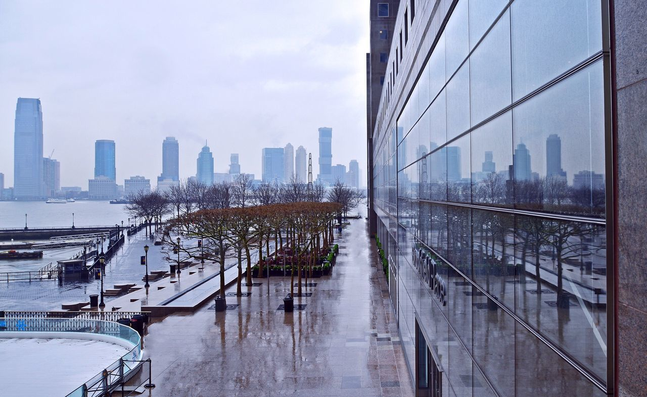 Skyline and reflection View Cityscapes River View River Water Skyline New York Skyline Buildings NYC New York NYC Photography Showcase April New York City Streetphotography Street Photography City Rainy Wet Floor Reflection Reflections Building Reflections The Architect - 2016 EyeEm Awards