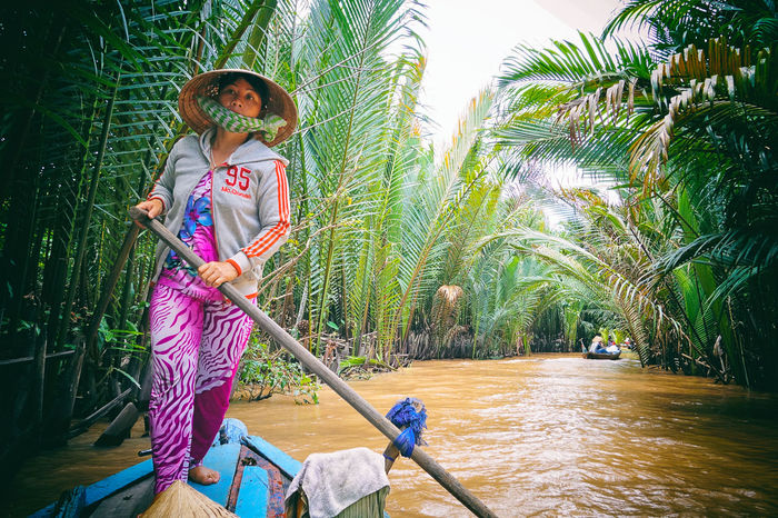 Connected By Travel Beauty In Nature Day Full Length Nature One Person Outdoors Palm Tree People Real People Tree Water EyeEmNewHere River An Eye For Travel