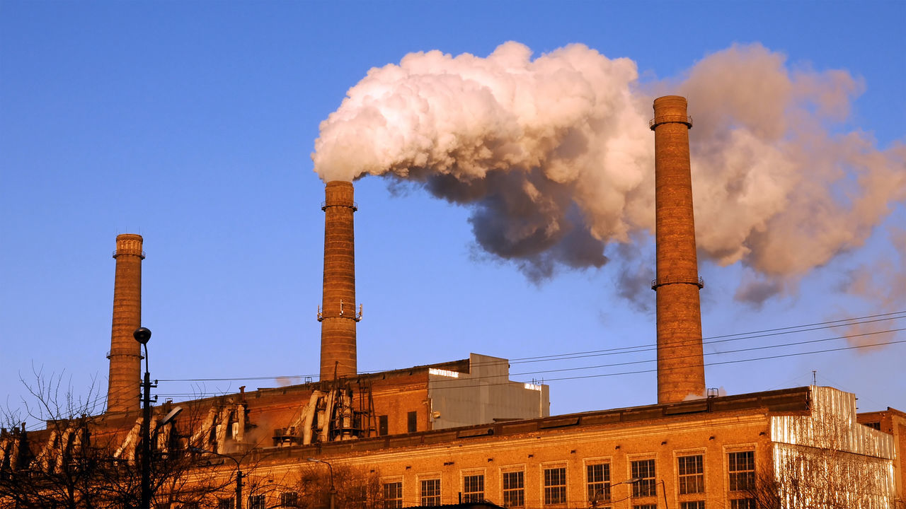 smoke stack, industry, factory, smoke - physical structure, emitting, air pollution, pollution, built structure, architecture, chimney, environment, no people, building exterior, sky, outdoors, day, low angle view, clear sky