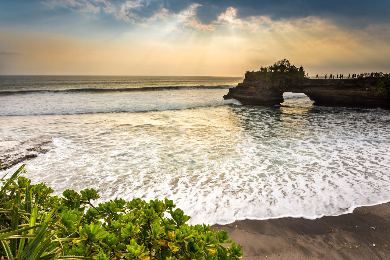 Sunset at Tanah Lot, a popular tourist attraction in Bali, Indonesia. Architecture Bali Beach Beauty In Nature Clouds Clouds And Sky Cloudscape Horizon Over Water INDONESIA Island Moss Nature Outdoors Pura Rock Formation Scenics Sea Sunset Sunsets Tanah Lot Temple Tourist Tourist Attraction  Travel Destinations Waves