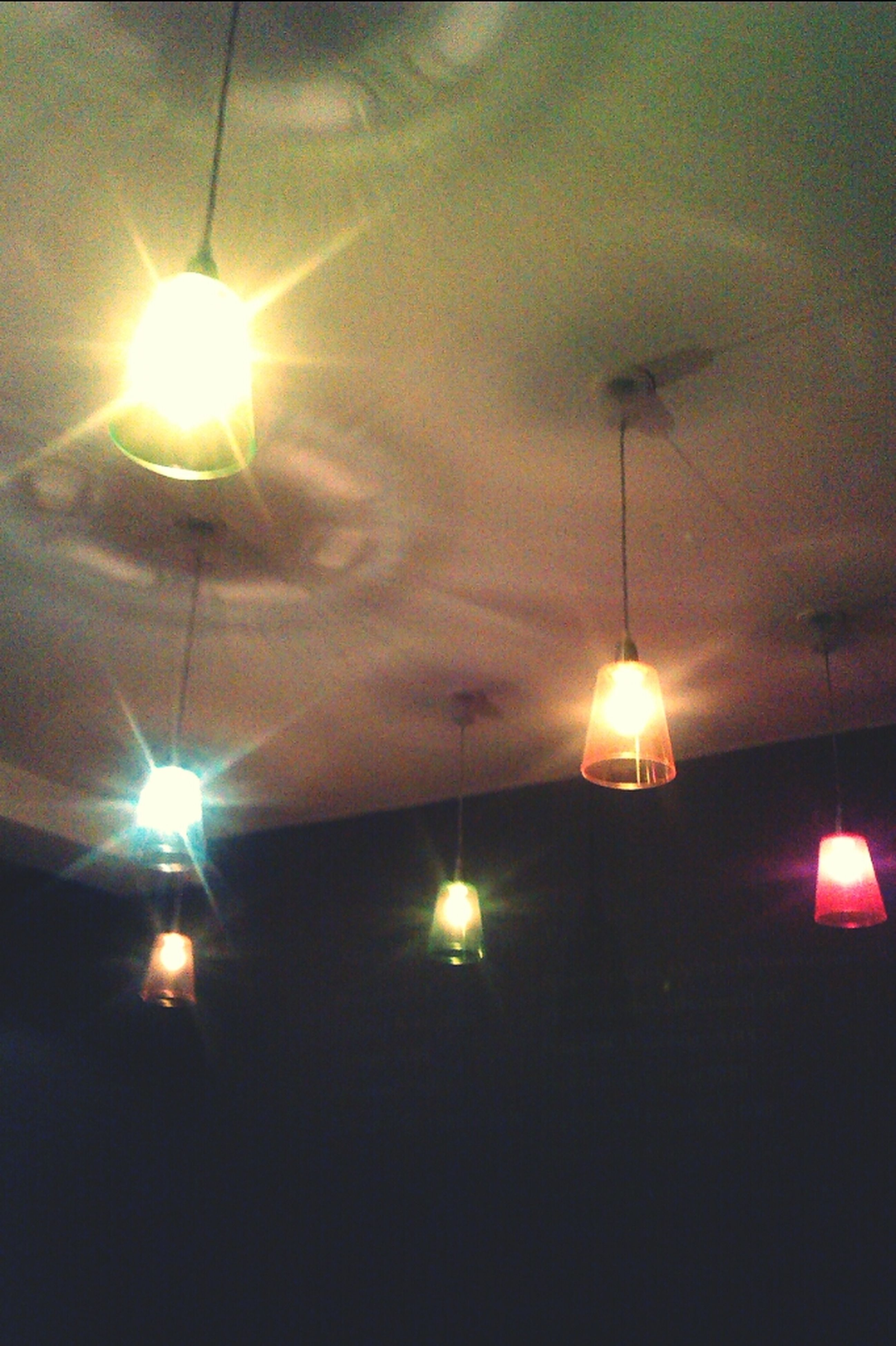 illuminated, lighting equipment, electricity, electric light, street light, low angle view, indoors, electric lamp, glowing, ceiling, hanging, light - natural phenomenon, night, lamp, decoration, lit, lantern, light bulb, no people, in a row